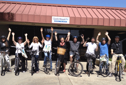 Bicyclists participating in Bike to Work Day pose for a photo.