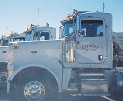 Image of a white semi truck with Chavez Truck on the side.