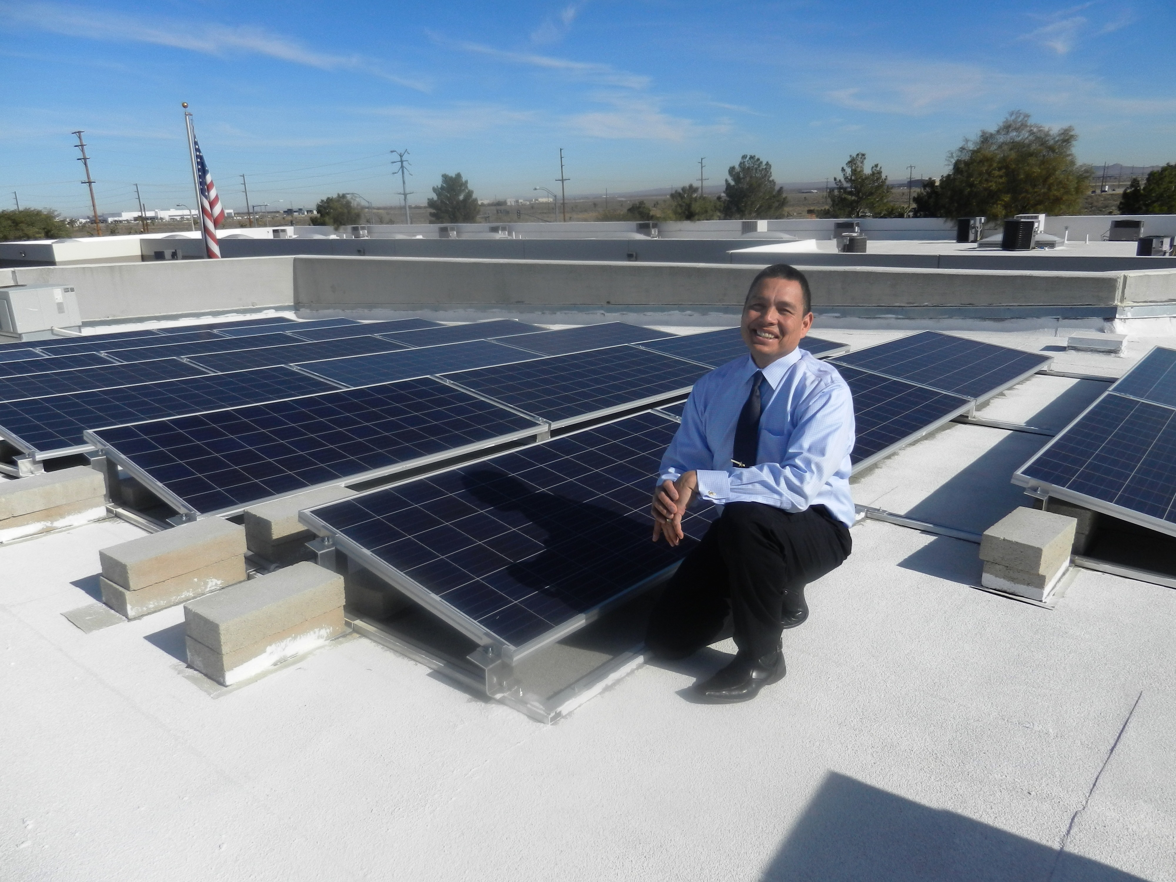 Terry Norris shows us the solar panels on the roof of Precision Labs Calibration.