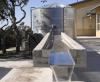 Image of a large metal rain cistern